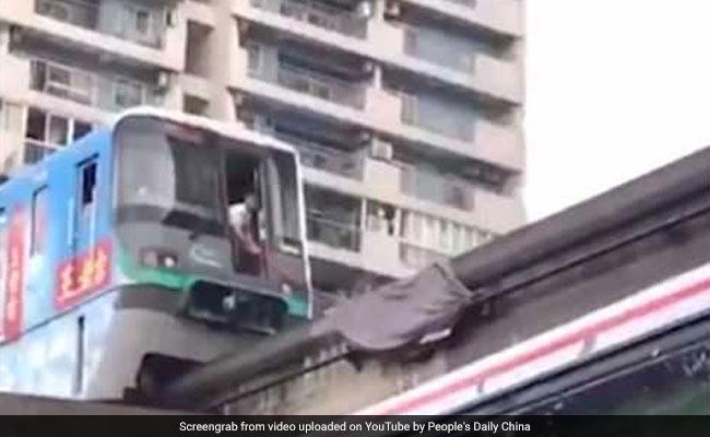 Train That Passes Through High-Rise Comes To Halt For The Weirdest Reason