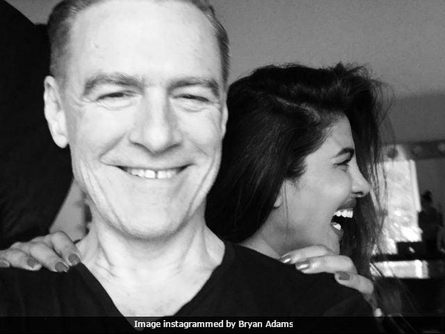 priyanka chopra smiles as bryan adams clicks see pics