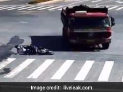Watch: Bike Skids Under Truck, Rider Walks Away Unhurt
