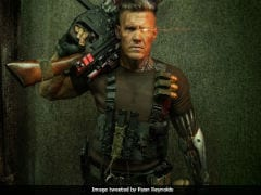 <i>Deadpool 2</i>: Ryan Reynolds Posts First Look Of Josh Brolin As Cable. With Guns And, Umm, Teddy Bear