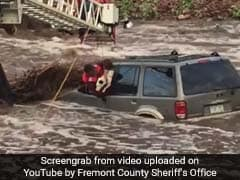 Watch: Dramatic Rescue Of Man, Dog Trapped In Car During Flash Floods
