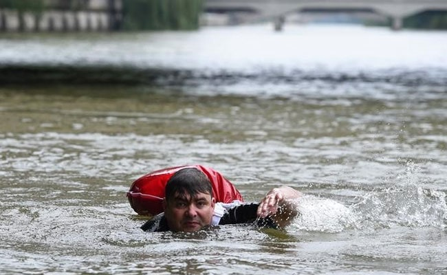 german man swims to work reuters 650