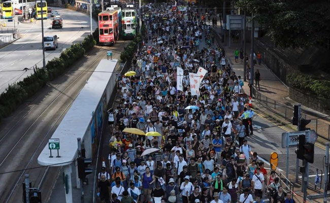Thousands protest jailing of Umbrella Movement leaders