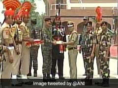 Indian, Pakistani Border Guards Exchange Sweets On Independence Day