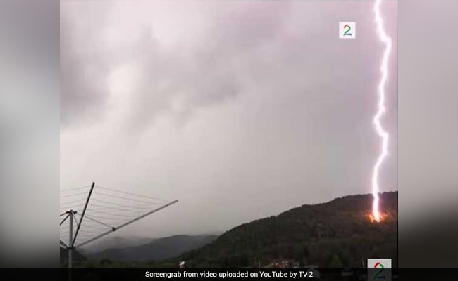 Lucky Escape For Man Filming Thunder As Lightning Strikes Meters From Him
