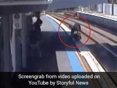 Caught On CCTV: Mum Rescues Baby From Train Tracks With Seconds To Spare