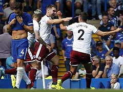 Premier League: Burnley Stun Nine-Man Chelsea, Arsenal Beat Leicester City