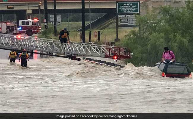 Watch: Rescue Of Man Stranded On SUV Rooftop In Raging Floods