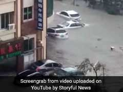 Shocking Video Shows Cars Floating In Floodwater As Typhoon Sweeps China
