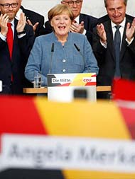 Merkel Heads For 4th Term In Germany, But Far Right Spoils Victory Party