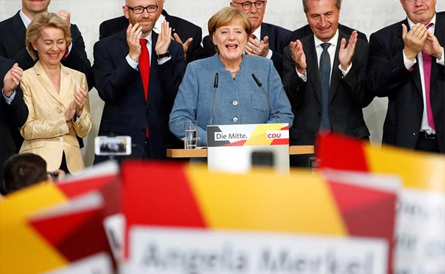 Merkel Heads For Another Term In Germany, But Far Right Spoils The Party