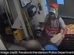 Watch: Man Dressed As Coca-Cola Bottle Robs Restaurant. No, Really