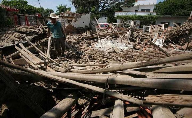 Mexico reels under double blow of natural disaster and Katia