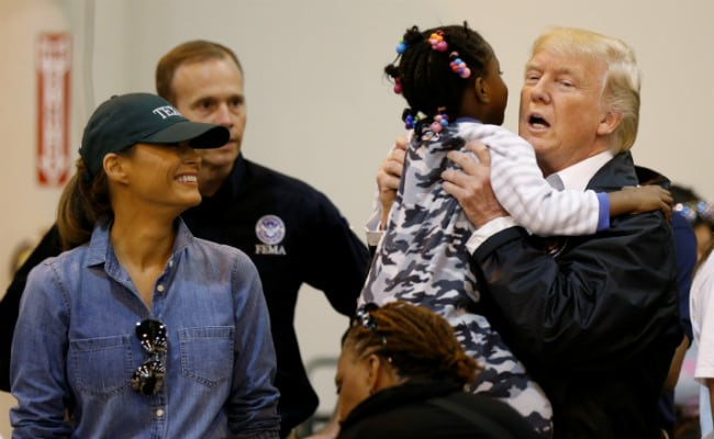 Donald Trump Hugs Children, Serves Food In Visit To Victims Of Harvey