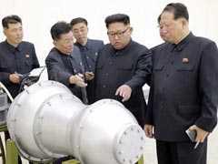 North Korea's Kim Jong Un Fetes Rocket Scientists, Promises More Weapons