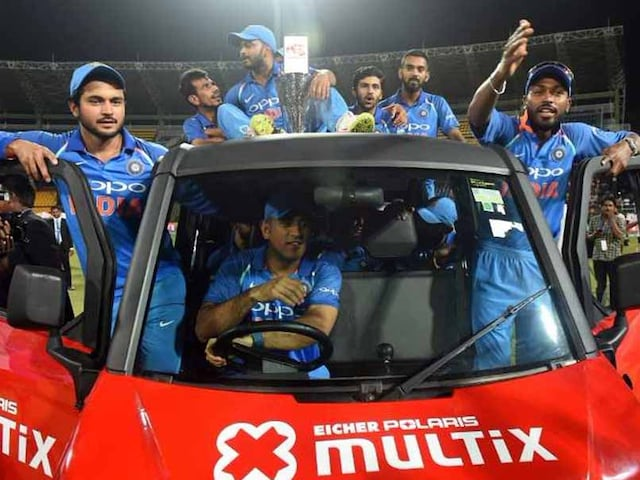 MS Dhoni Enthralls Fans By Taking Jasprit Bumrahs Man Of The Series Award For A Spin