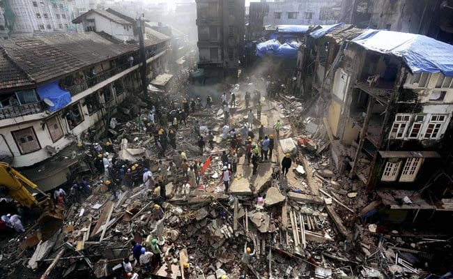 Nine dead and 20 trapped under collapsed building following Mumbai floods