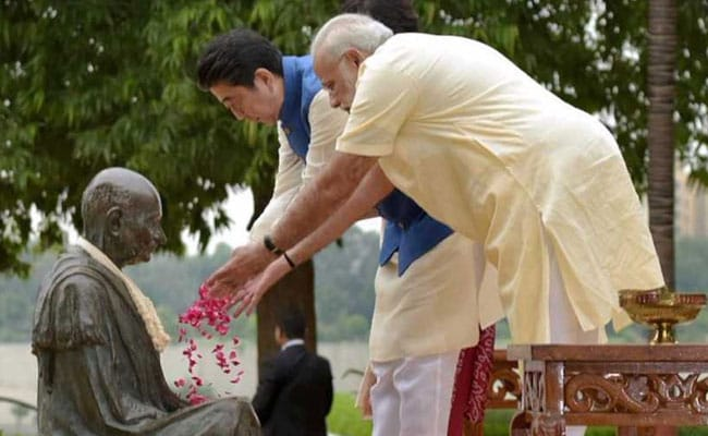 pm modi with shinzo abe at gandhi ashram pti