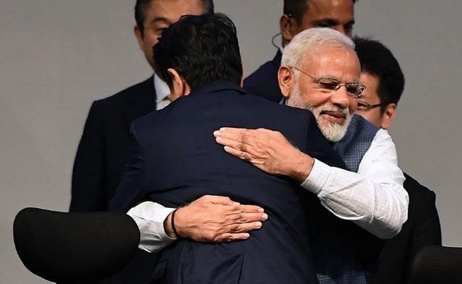 pm narendra modi singhzo abe hug afp