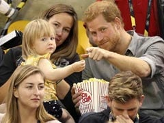 Watch This Little Girl Steal Prince Harry's Popcorn - And All Of Our Hearts