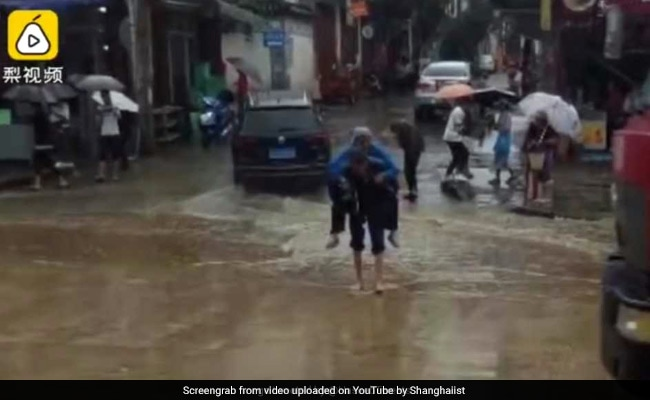 Heartwarming Video Shows Elderly Man Carrying Wife On Back Over Puddle