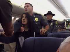 Caught On Camera: Cops Tug At Woman Passenger, Drag Her Down Aisle