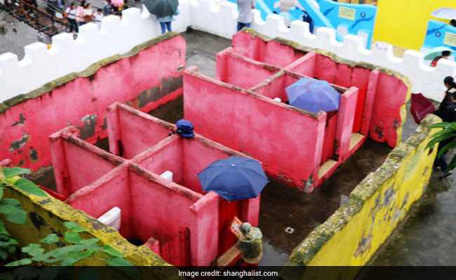 People Forced To Carry Umbrellas To Bizarre Toilets With No Ceilings