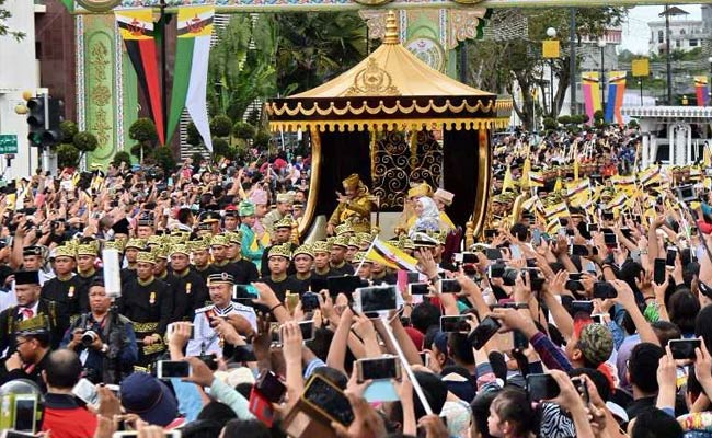 Sultan Of Bling: Brunei Monarch Travels In Gilded Chariot