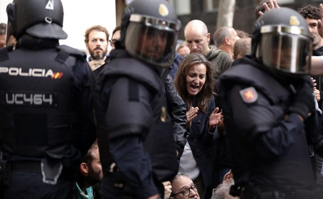 Police Force Way Into Polling Station Where Catalan Leader Was To Vote