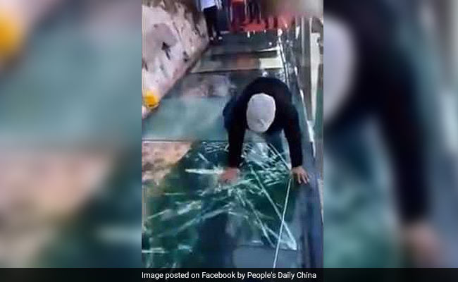 In China, Glass Bridge 'Cracks' With Each Step. Dare To Walk On It?
