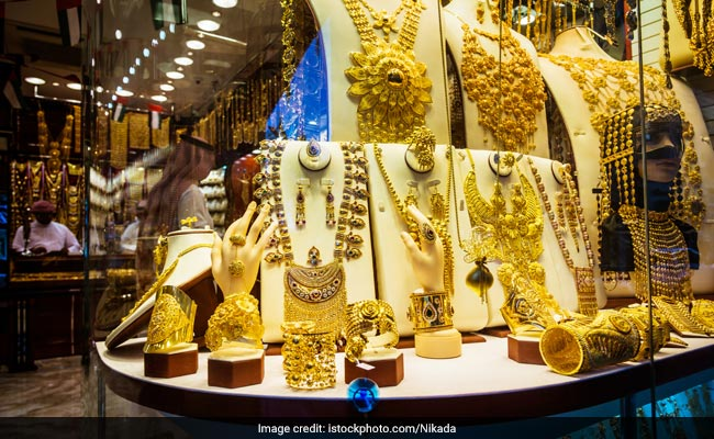 Standard gold prices eased by Rs 5 to close at Rs 29,235 per 10 grams