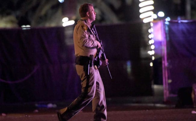 A Las Vegas cop patrolling the streets after reports of an active shooter at the Route 91 Harvest concert