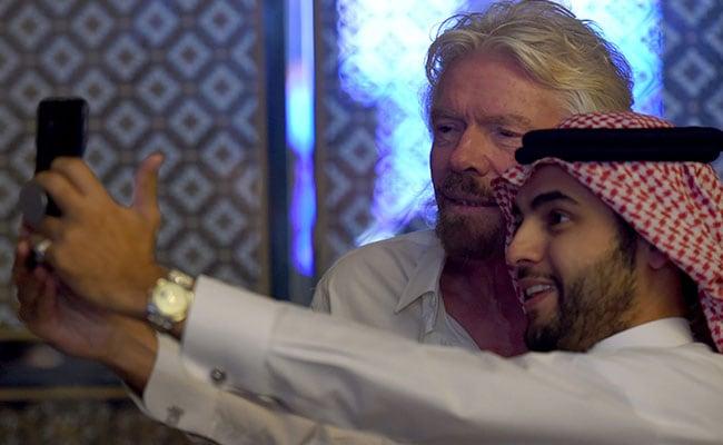 richard branson saudi man selfie afp