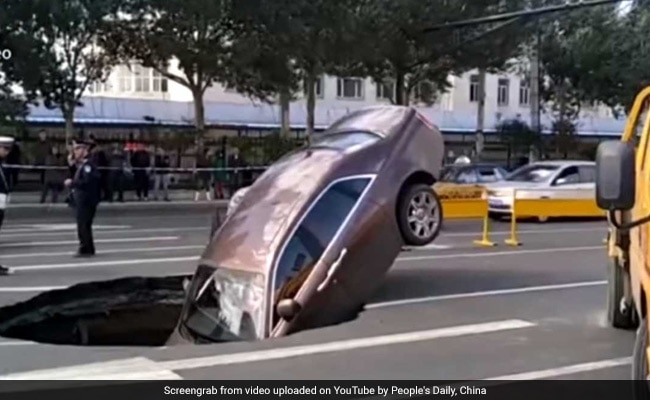 Rolls-Royce Plunges Into Sinkhole, Owner Forced To Climb Out Of Window