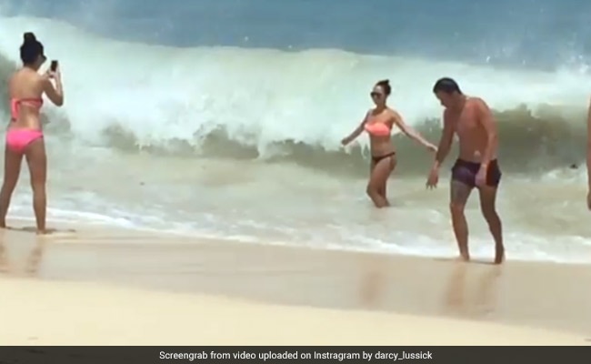 She Posed For A Photo At The Beach. But Ocean Played Spoilsport. Watch