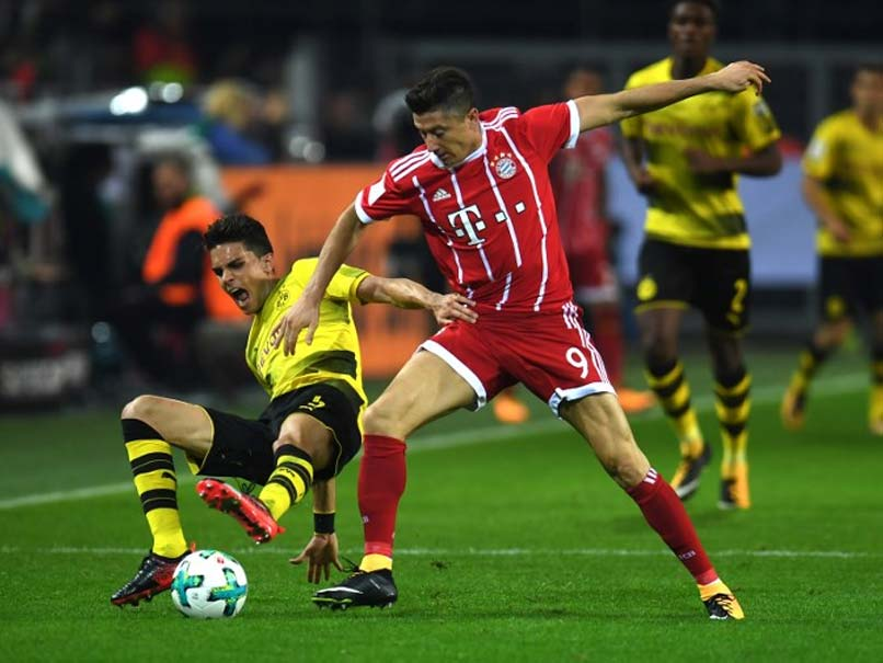 Dazzling Bayern charge past Dortmund 3-1 to go four points clear