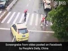 Car Blocks Traffic So Elderly Woman Can Cross Road. Video Is Heartwarming