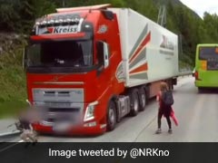 Heart-Stopping Moment Child Runs Into Traffic, Is Almost Run Over By Truck