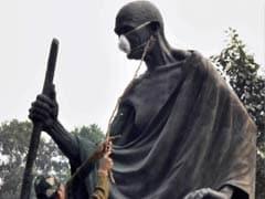 Delhi Lawmakers Tie Protective Mask On Mahatma Gandhi's Statue