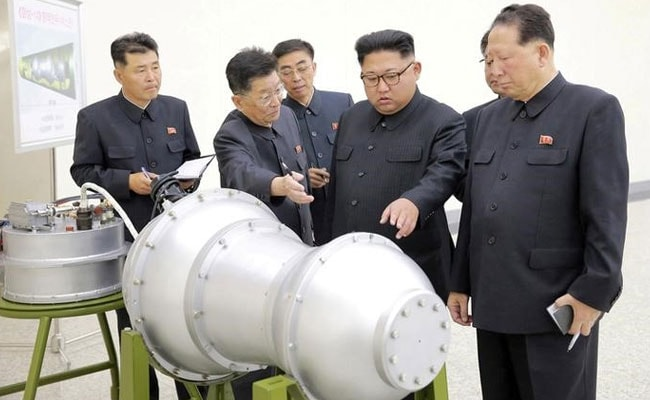 North Korea's Kim Jong Un Fetes Rocket Scientists, Promises More Weapons