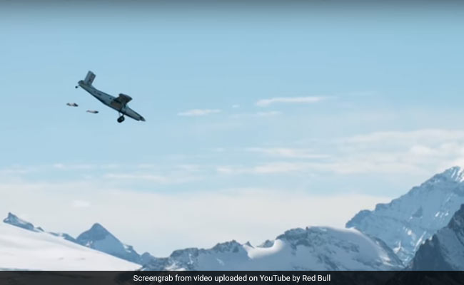 Watch 2 insane wingsuit flyers land into a moving plane