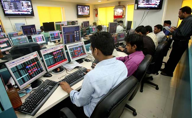 Equity indices trade in red, metal stocks lag