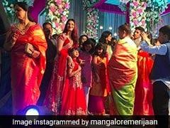 शादी में मैचिंग रेड ड्रेस पहनकर पहुंची ऐश्वर्या और आराध्या, तस्वीरें देखकर आप भी कहेंगे WOW