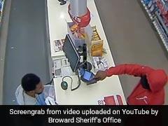 Watch: Robber Points Gun At Cashier. Intense Stare-Down Follows...