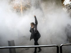 Iran Protesters Attack Religious School As US Sanction Tensions Mount