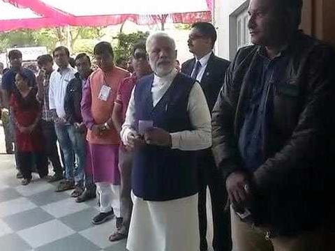 PM Modi gets in queue to vote in Gujarat, cheered by huge crowd. Read here