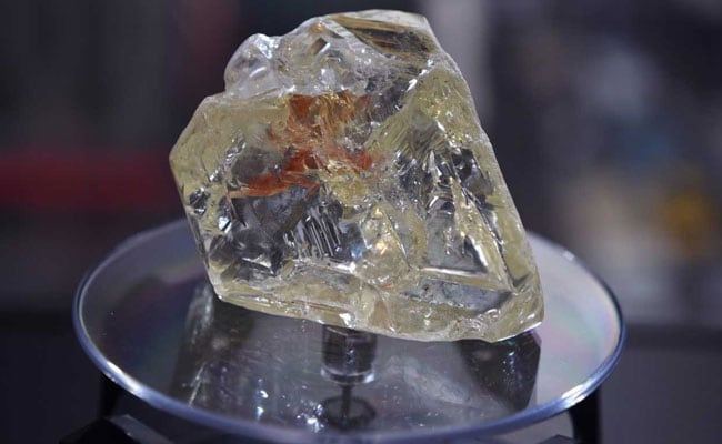 lesotho firestone large eng type the national gems uncovered light rough while found at left color yellow ii on in diamond let finds d diamonds two carat jeweler supply gem