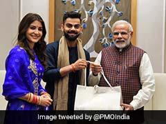 Reception: पीएम मोदी को इनवाइट करने पहुंचे विराट कोहली और अनुष्का शर्मा, दिया ये खास 'तोहफा'