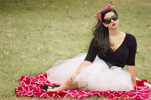 woman dressed stylishly in a park
