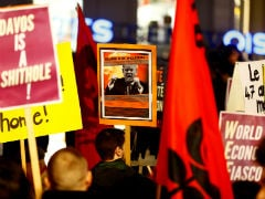 Swiss Marchers Protest Against Trump, Break Through Davos Security Cordon